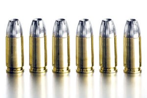 bullets 9mm closeup on brushed metal, white background, high contrast